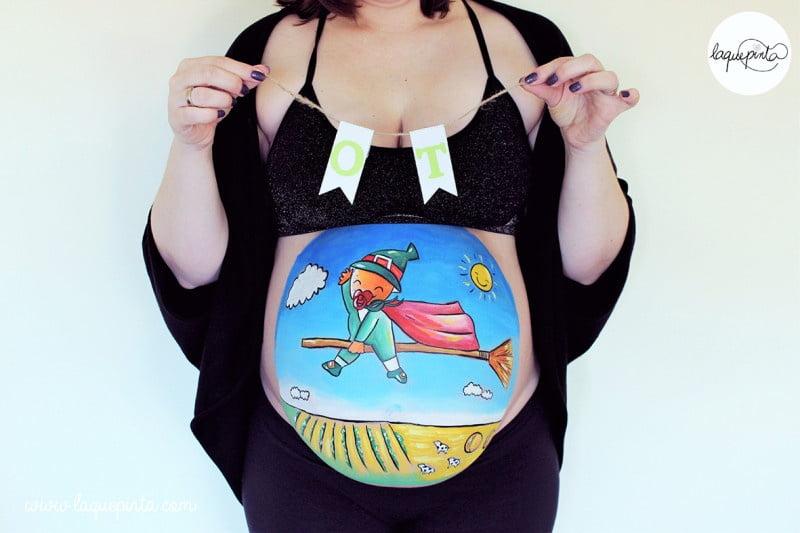 Body painting para embarazada con barriga pintada con dibujo de mini guerrero de La que pinta con barriga pintada con dibujo de Ot el Bruixot volando sobre el huerto de su mami de La que pinta en Barcelona