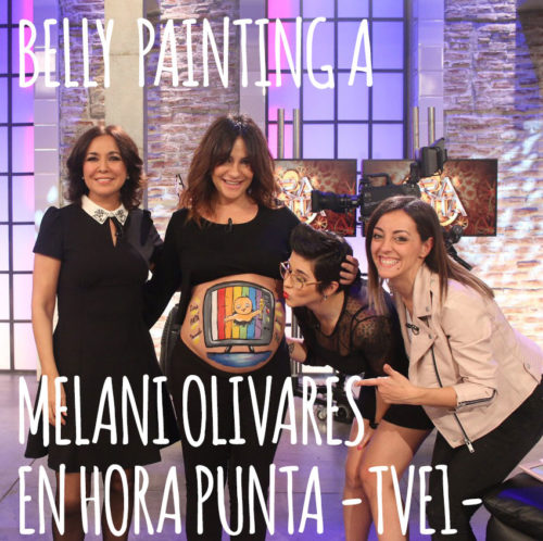 Body painting para Melani Olivares y su barriga de embarazada pintada con un dibujo de un niño saliendo de la televisióncon un oscar en la mano, pintado a mano por La que pinta Barcelona en el programa Hora Punta de TVE1.